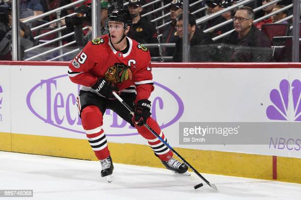 Jonathan Toews of the Chicago Blackhawks receives the puck in the first period against the Anaheim Ducks at the United Center on November 27 2017 in...
