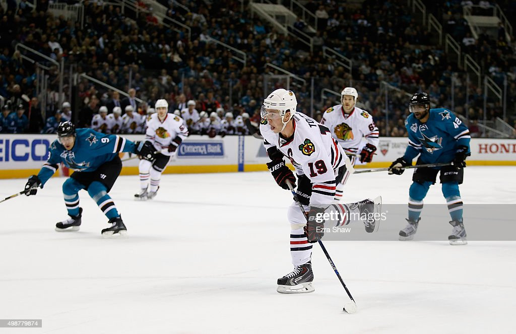 Jonathan Toews #19 of the Chicago Blackhawks scores a goal against the San Jose Sharks in the first period at SAP Center on November 25, 2015 in San Jose, California.
