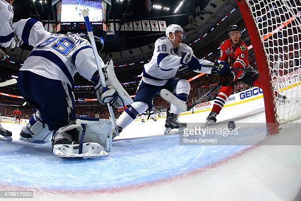 Jonathan Toews of the Chicago Blackhawks scores a goal in the second period against Andrei Vasilevskiy of the Tampa Bay Lightning during Game Four of...