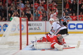 Jonathan Toews of the Chicago Blackhawks scores a shootout goal against Jonas Gustavsson of the Detroit Red Wings during an NHL game on January 22...