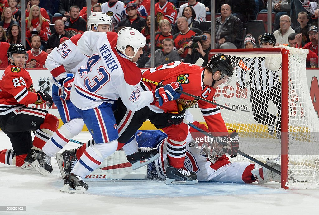 Jonathan Toews of the Chicago Blackhawks scores on goalie Carey Price of the Montreal Canadiens as Mike Weaver follows behind in the third period...