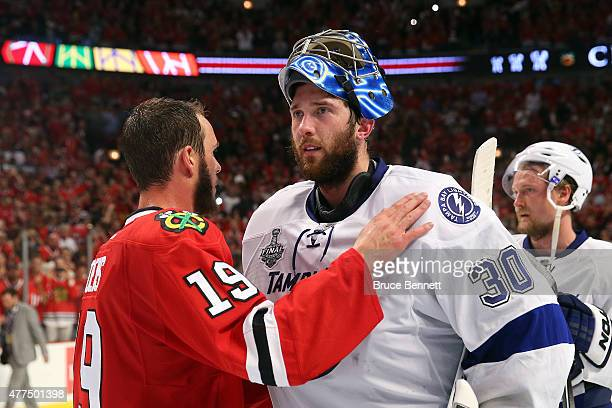 Jonathan Toews of the Chicago Blackhawks shakes hands with Ben Bishop of the Tampa Bay Lightning after the Blackhawks won Game Six by a score of 20...