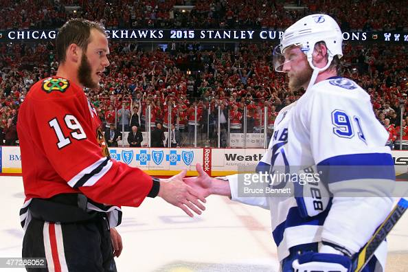 Jonathan Toews of the Chicago Blackhawks shakes hands with Steven Stamkos of the Tampa Bay Lightning after the Blackhawks won Game Six by a score of...