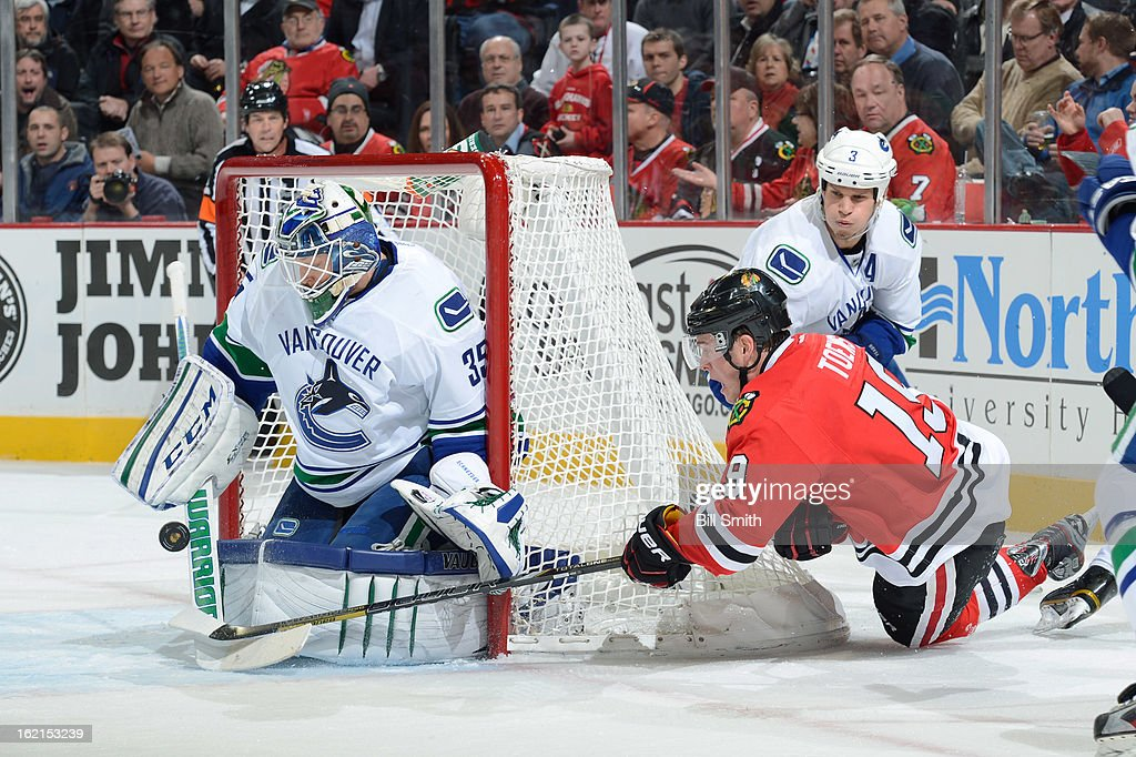 <a gi-track='captionPersonalityLinkClicked' href=/galleries/search?phrase=Jonathan+Toews&family=editorial&specificpeople=537799 ng-click='$event.stopPropagation()'>Jonathan Toews</a> #19 of the Chicago Blackhawks shoots the puck at goalie <a gi-track='captionPersonalityLinkClicked' href=/galleries/search?phrase=Cory+Schneider&family=editorial&specificpeople=696908 ng-click='$event.stopPropagation()'>Cory Schneider</a> #35 of the Vancouver Canucks during the NHL game on February 19, 2013 at the United Center in Chicago, Illinois.