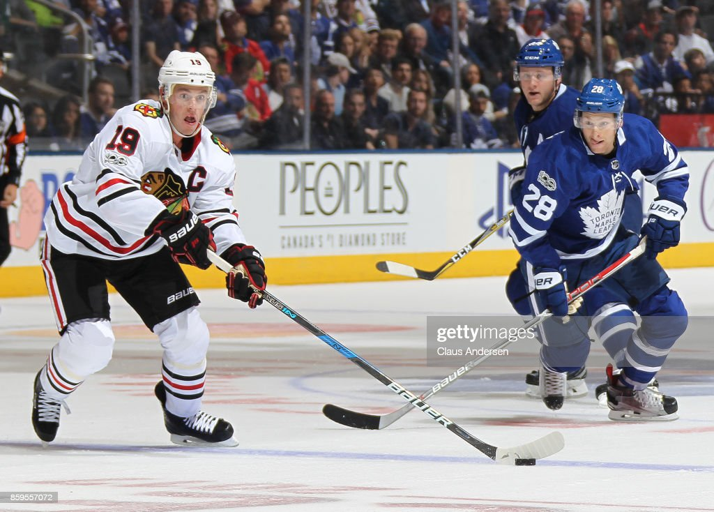 Jonathan Toews #19 of the Chicago Blackhawks skates against Connor Brown #28 of the Toronto Maple Leafs in an NHL game at the Air Canada Centre on October 9, 2017 in Toronto, Ontario. The Maple Leafs defeated the Blackhawks 4-3 in overtime
