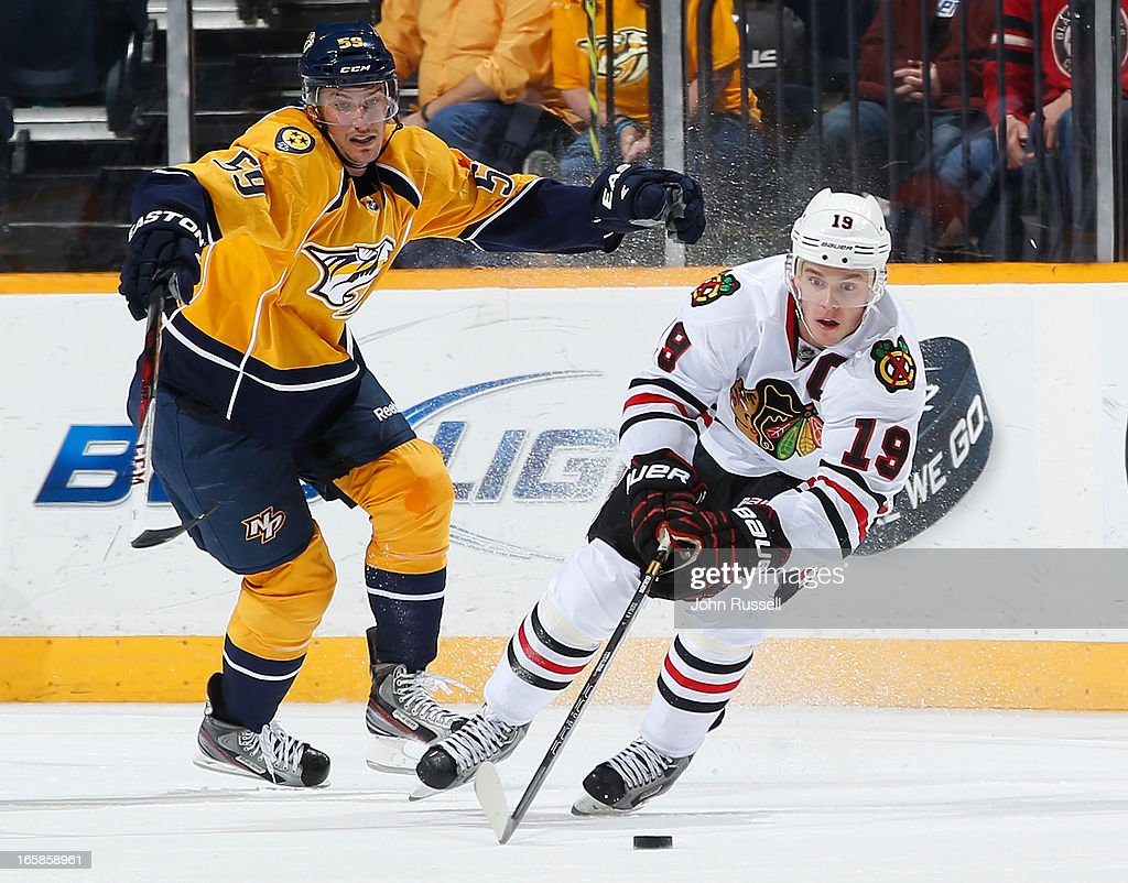 <a gi-track='captionPersonalityLinkClicked' href=/galleries/search?phrase=Jonathan+Toews&family=editorial&specificpeople=537799 ng-click='$event.stopPropagation()'>Jonathan Toews</a> #19 of the Chicago Blackhawks skates against <a gi-track='captionPersonalityLinkClicked' href=/galleries/search?phrase=Roman+Josi&family=editorial&specificpeople=4247871 ng-click='$event.stopPropagation()'>Roman Josi</a> #59 of the Nashville Predators during an NHL game at the Bridgestone Arena on April 6, 2013 in Nashville, Tennessee.