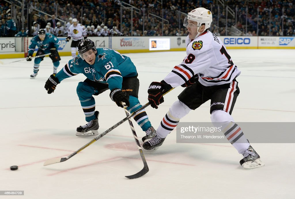 <a gi-track='captionPersonalityLinkClicked' href=/galleries/search?phrase=Jonathan+Toews&family=editorial&specificpeople=537799 ng-click='$event.stopPropagation()'>Jonathan Toews</a> #19 of the Chicago Blackhawks skates for control of the puck with Justin Braun #61 of the San Jose Sharks during the third period at SAP Center on February 1, 2014 in San Jose, California. The Sharks won the game 2-1 in an overtime shoot-out.