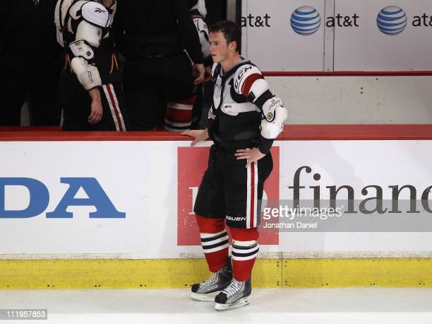 Jonathan Toews of the Chicago Blackhawks stands by the bench after giving his jersey to a fan after a loss to the Detroit Red Wings at the United...