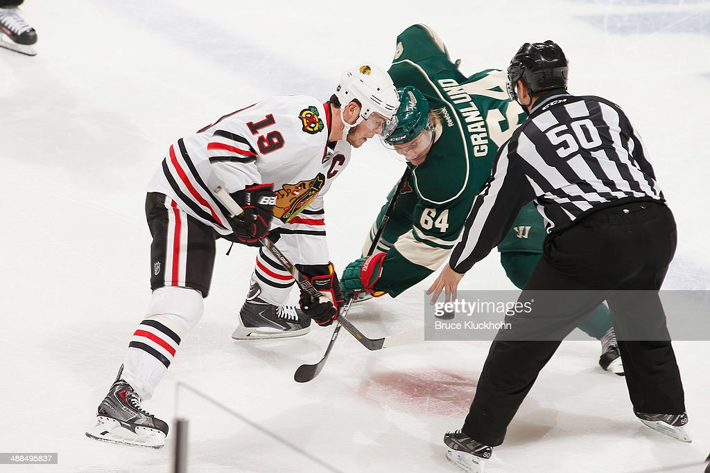 Jonathan Toews #19 of the Chicago Blackhawks takes a face-off against Mikael Granlund #64 of the Minnesota Wild during Game Three of the Second Round of the 2014 Stanley Cup Playoffs on May 6, 2014 at the Xcel Energy Center in St. Paul, Minnesota.