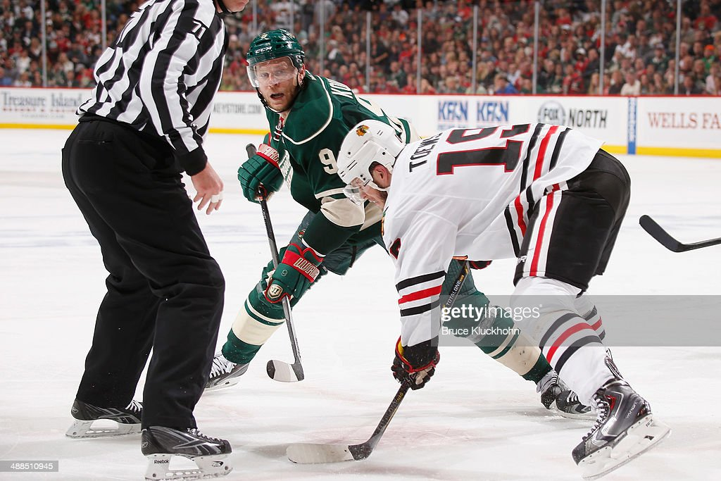 Jonathan Toews #19 of the Chicago Blackhawks takes a face-off against Mikko Koivu #9 of the Minnesota Wild during Game Three of the Second Round of the 2014 Stanley Cup Playoffs on May 6, 2014 at the Xcel Energy Center in St. Paul, Minnesota.