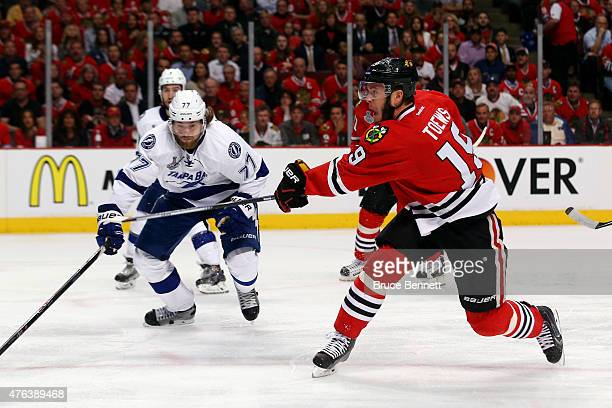 Jonathan Toews of the Chicago Blackhawks takes a shot in the first period against the Tampa Bay Lightning during Game Three of the 2015 NHL Stanley...