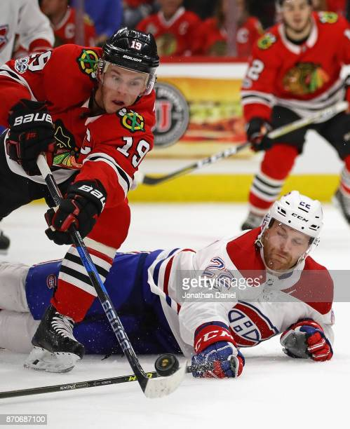 Jonathan Toews of the Chicago Blackhawks tries to get off a shot against Karl Alzner of the Montreal Canadiens at the United Center on November 5...