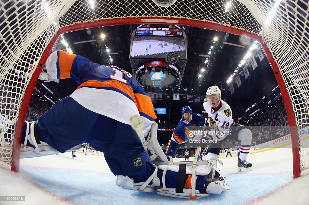 Jonathan Toews #19 of the Chicago Blackhawks watches a shot by Patrick Kane #88 (not pictured) go into the net at 1:49 of overtime against Thomas Greiss #1 of the New York Islanders at the Barclays Center on October 9, 2015 in Brooklyn borough of New York City. The game is the first for the Islanders in their new arena. The Blackhawks defeated the Islanders 3-2 in overtime.