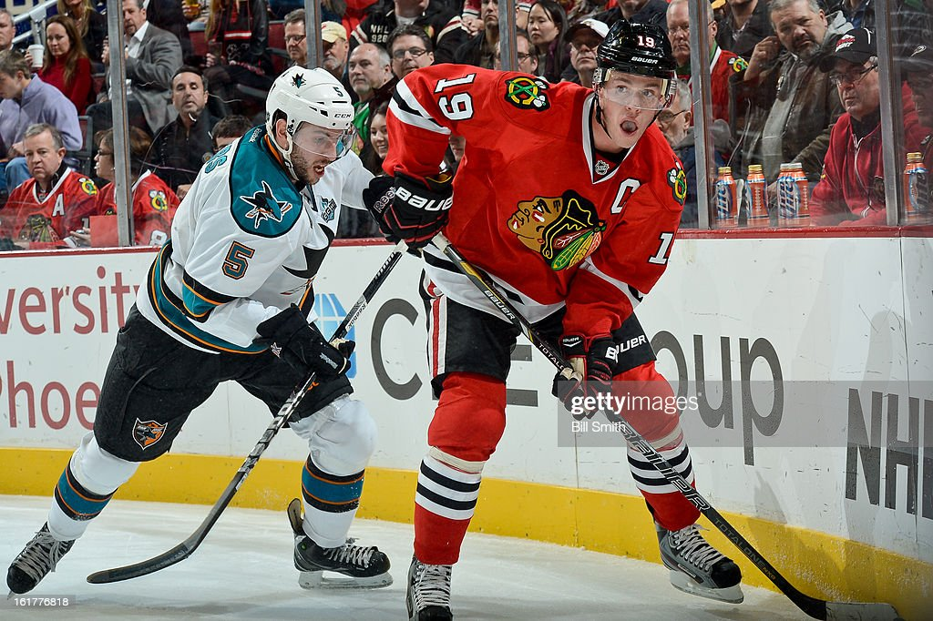 <a gi-track='captionPersonalityLinkClicked' href=/galleries/search?phrase=Jonathan+Toews&family=editorial&specificpeople=537799 ng-click='$event.stopPropagation()'>Jonathan Toews</a> #19 of the Chicago Blackhawks watches for the puck as <a gi-track='captionPersonalityLinkClicked' href=/galleries/search?phrase=Jason+Demers&family=editorial&specificpeople=2282534 ng-click='$event.stopPropagation()'>Jason Demers</a> #5 of the San Jose Sharks skates up from behind during the NHL game on February 15, 2013 at the United Center in Chicago, Illinois.