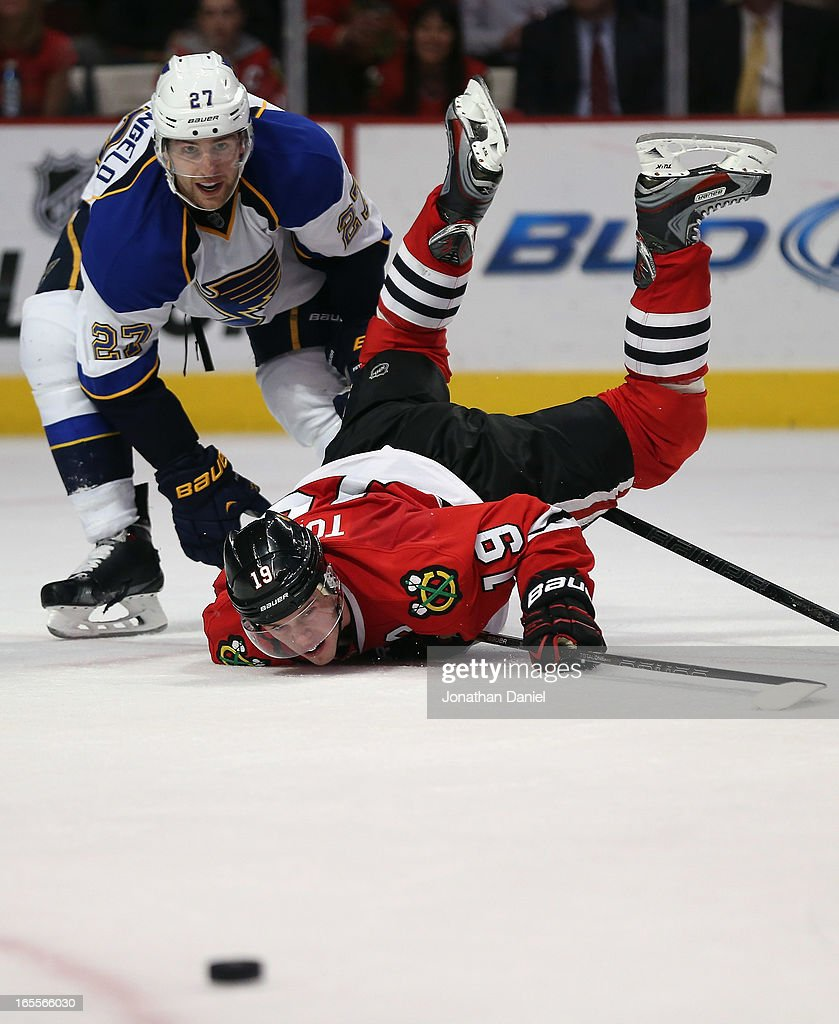 Jonathan Toews #19 of the Chicago Blackhawks watches the puck slide away after battling with Alex Pietrangelo #27 of the St. Louis Blues at the United Center on April 4, 2013 in Chicago, Illinois. The Blues defeated the Blackhawks 4-3 in a shootout.
