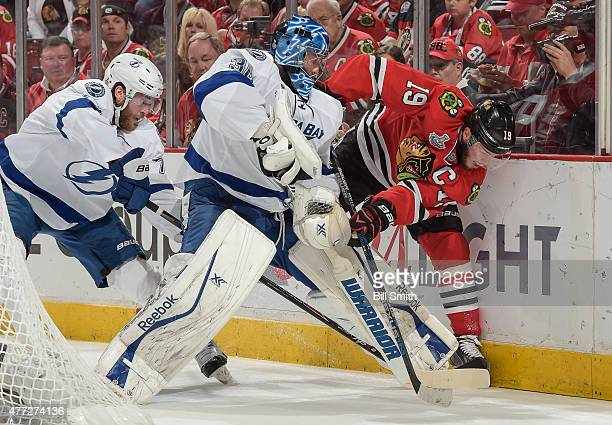 Jonathan Toews of the Chicago Blackhawks works to get the puck against goalie Ben Bishop of the Tampa Bay Lightning as Victor Hedman of the Tampa Bay...