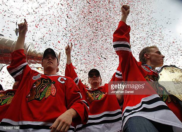 Jonathan Toews Tomas Kopecky and Patrick Kane celebrate with the crowd during the Chicago Blackhawks Stanley Cup victory parade and rally on June 11...