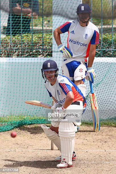 Jonathan Trott is watched closely by Alastair Cook during batting practise during the England nets session at Kensington Oval ahead of the 3rd Test...