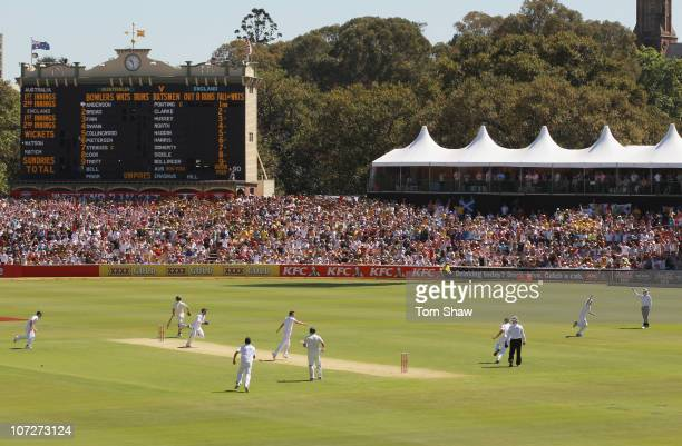 Jonathan Trott of England celebrates taking the run out of Simon Katich of Australia during day one of the Second Ashes Test match between Australia...