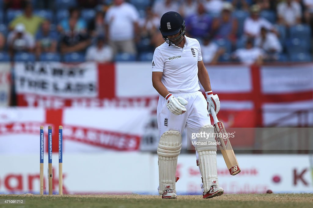 <a gi-track='captionPersonalityLinkClicked' href=/galleries/search?phrase=Jonathan+Trott&family=editorial&specificpeople=654505 ng-click='$event.stopPropagation()'>Jonathan Trott</a> of England heads back to the pavillion after being bowled for a duck by Shannon Gabriel of West Indies during day five of the 2nd Test match between West Indies and England at the National Cricket Stadium in St George's on April 25, 2015 in Grenada, Grenada.