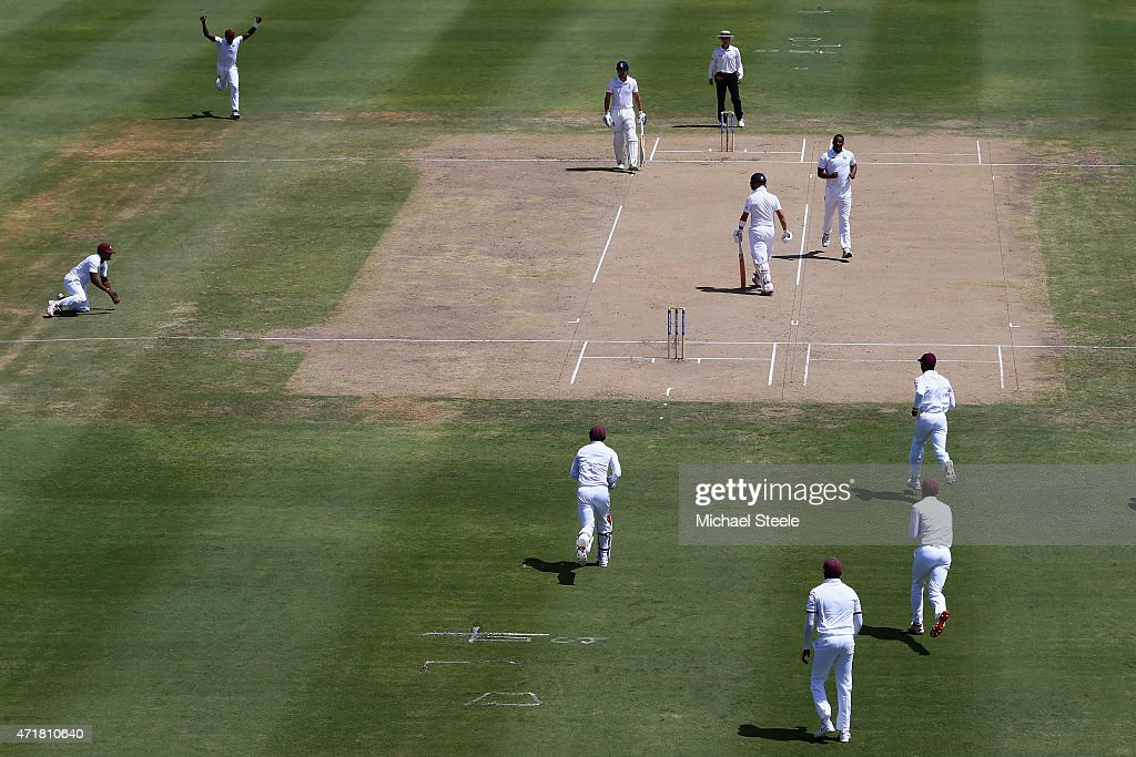 Jonathan Trott of England heads back to the pavillion for a duck after being caught by Veerasammy Permaul (L) off the bowling of Shannon Gabriel of West Indies during day one of the 3rd Test match between West Indies and England at Kensington Oval on May 1, 2015 in Bridgetown, Barbados.