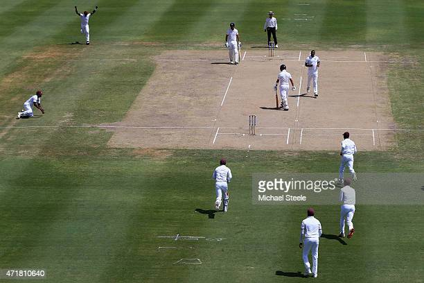 Jonathan Trott of England heads back to the pavillion for a duck after being caught by Veerasammy Permaul off the bowling of Shannon Gabriel of West...