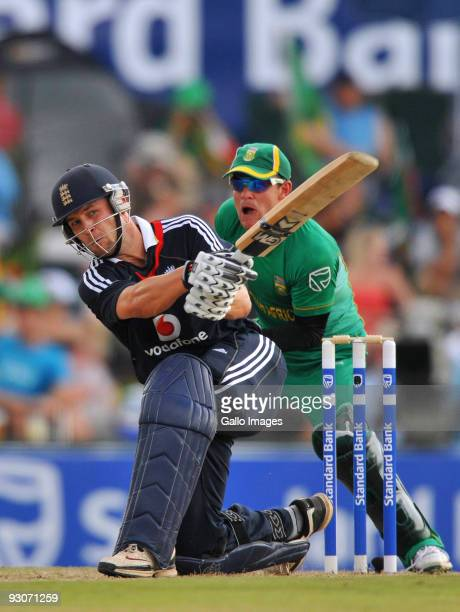 Jonathan Trott of England hits a boundary as Heino Kuhn of South Africa looks on during the 2nd Twenty20 international match between South Africa and...