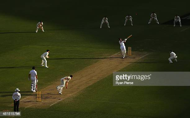 Jonathan Trott of England hooks Mitchell Johnson of Australia during day three of the First Ashes Test match between Australia and England at The...