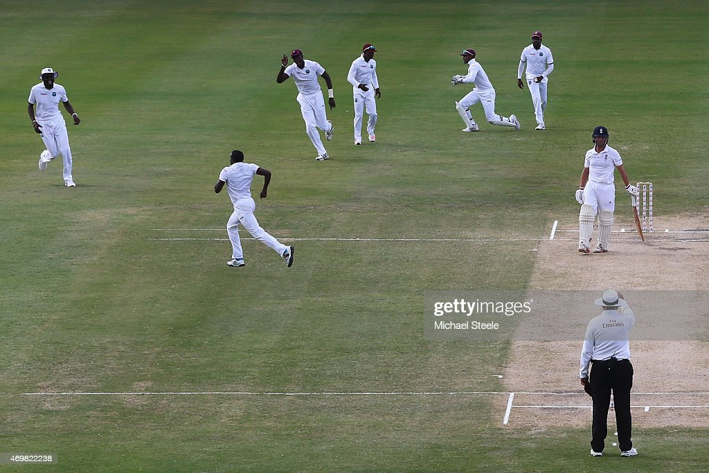 Jonathan Trott of England is caught by wicketkeeper Denesh Ramdin for 4 runs off the bowling of Jerome Taylor of West Indies during day three of the 1st Test match between West Indies and England at the Sir Vivian Richards Stadium on April 15, 2015 in Antigua, Antigua and Barbuda.