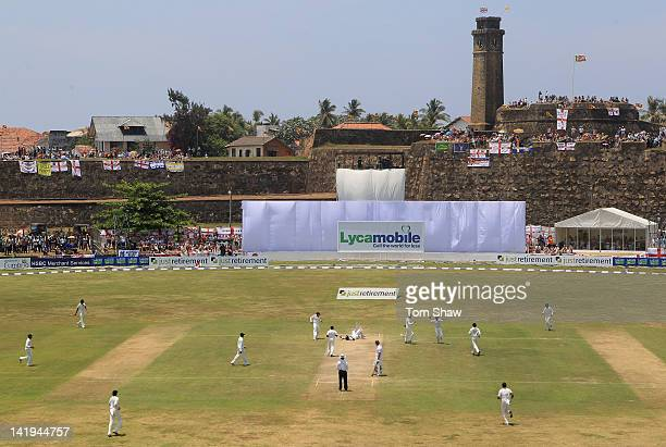 Jonathan Trott of England lies on the ground after colliding with the keeper Prasanna Jayawardene of Sri Lanka after being stumped during day 2 of...