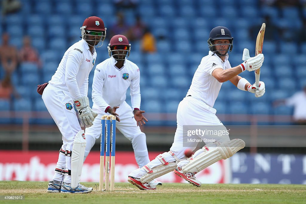 Jonathan Trott of England plays behind point as wicketkeeper Denesh Ramdin of West Indies looks on during day three of the 2nd Test match between West Indies and England at the National Cricket Stadium in St George's on April 23, 2015 in Grenada, Grenada.