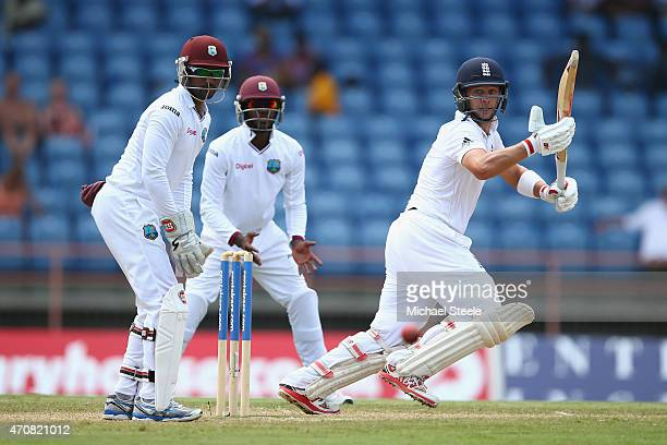 Jonathan Trott of England plays behind point as wicketkeeper Denesh Ramdin of West Indies looks on during day three of the 2nd Test match between...