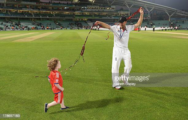 Jonathan Trott of England plays with his child after England won the Ashes Series during day five of the 5th Investec Ashes Test match between...