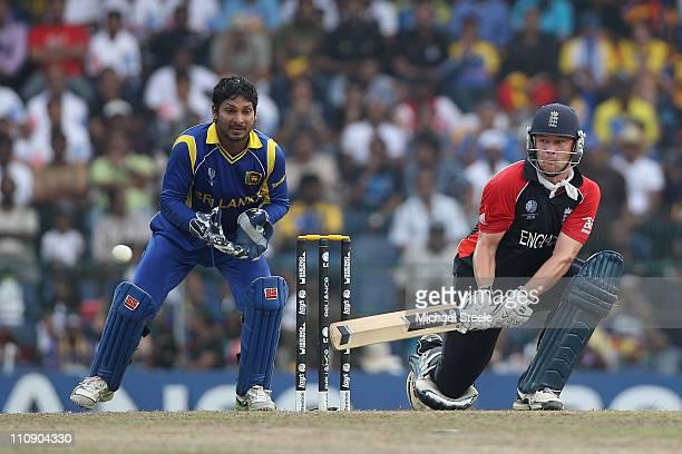 Jonathan Trott of England reverse sweeps as wicketkeeper Kumar Sangakkara looks on during the 2011 ICC World Cup QuarterFinal match between Sri Lanka...
