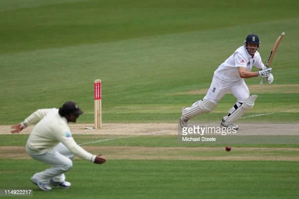 Jonathan Trott of England scores through the offside past Kumar Sangakkara during day four of the 1st npower test match between England and Sri Lanka...
