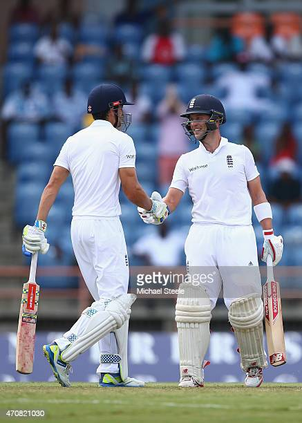 Jonathan Trott of England shakes hands with Alastair Cook after reaching his half century during day three of the 2nd Test match between West Indies...