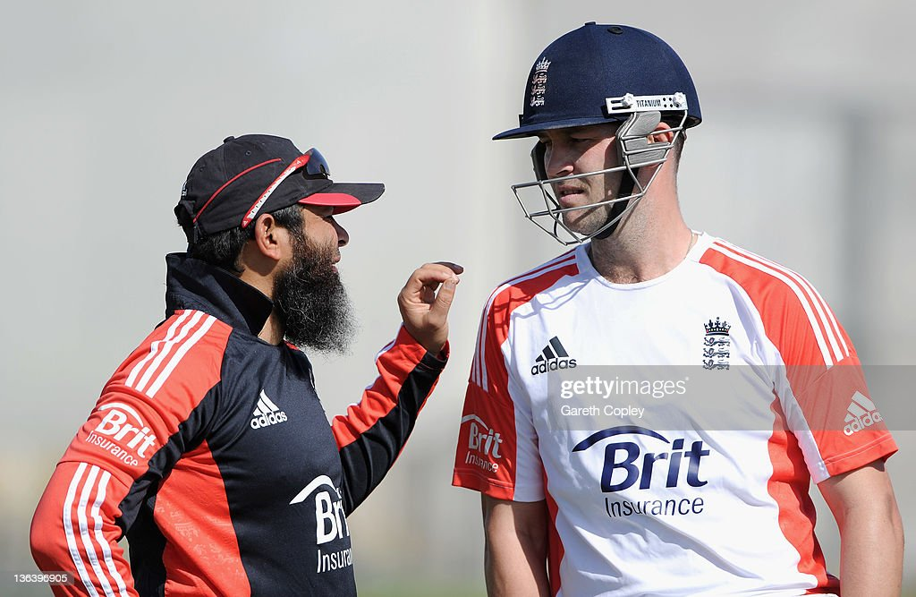 Jonathan Trott of England speaks with spinbowling coach Mushtaq Ahmed during a nets session at The ICC Global Academy on January 4 2012 in Dubai...