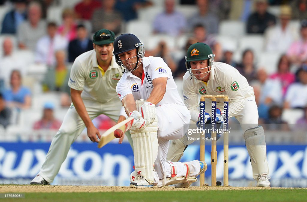 Jonathan Trott of England sweeps watched by wicketkeeper Brad Haddin and Shane Watson of Australia during day five of the 5th Investec Ashes Test match between England and Australia at the Kia Oval on August 25, 2013 in London, England.
