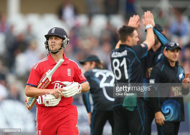 Jonathan Trott of England walks off the field having been dismissed off the bowling of Mitchell McClenaghan of New Zealand during the 3rd NatWest...