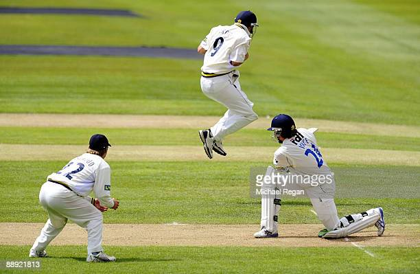 Jonathan Trott of Warwickshire attempts to move out of the way but ends up catching out Ed Joyce of Sussex as the ball goes straight into his pocket...
