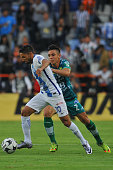 Jonathan Urretaviscaya of Pachuca vies for the ball with Efrain Velarde of Leon during their Mexican Apertura 2016 Tournament football match at the...