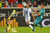 Jonathan Urretaviscaya of Pachuca vies for the ball with William Yarbrouhg the goalkeaper and Efrain Velarde of Leon during their Mexican Apertura...