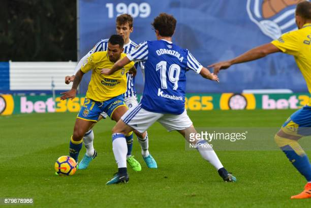 Jonathan Viera of U D Las Palmas duels for the ball with Alvaro Odriozola and Diego Llorente of Real Sociedad during the Spanish league football...