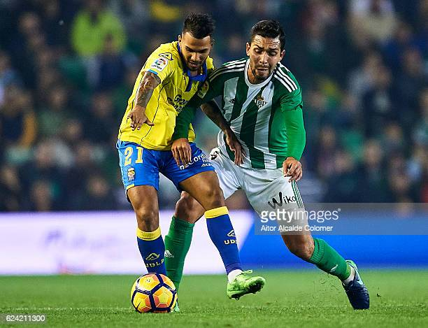 Jonathan Viera of UD Las Palmas competes for the ball with Petros Matheus dos Santos of Real Betis Balompie during the La Liga match between Real...