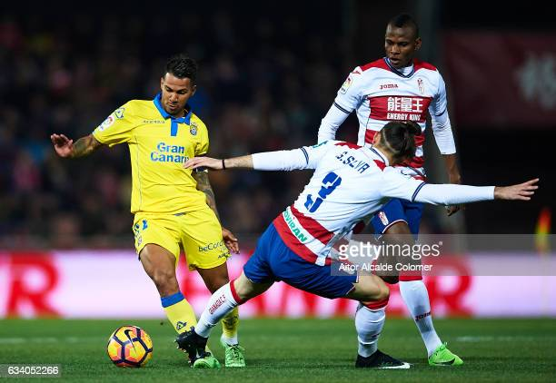 Jonathan Viera of Union Deportiva Las Palmas being followed by Gabriel Gaston Alexis Silva of Granada CF during the La Liga match between Granada CF...