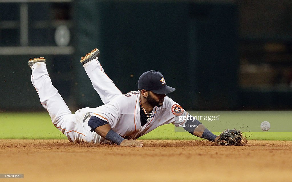 Jonathan Villar #6 of the Houston Astros attempts to make a play on a ground ball hit by David Ortiz of the Boston Red Sox in the sixth inning at Minute Maid Park on August 6, 2013 in Houston, Texas.