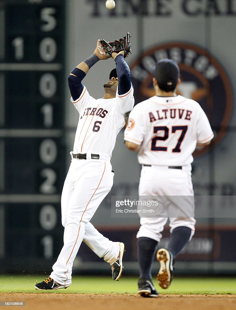 Jonathan Villar #6 of the Houston Astros catches an infield fly ball for an out as Jose Altuve #27 looks on during the ninth inning against the New York Yankees on September 29, 2013 at Minute Maid Park in Houston, TX.