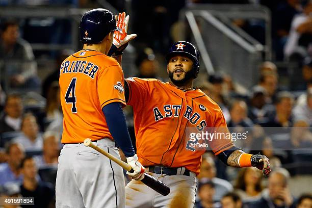 Jonathan Villar of the Houston Astros celebrates with George Springer after scoring a run on Jose Altuve single to left against Dellin Betances of...