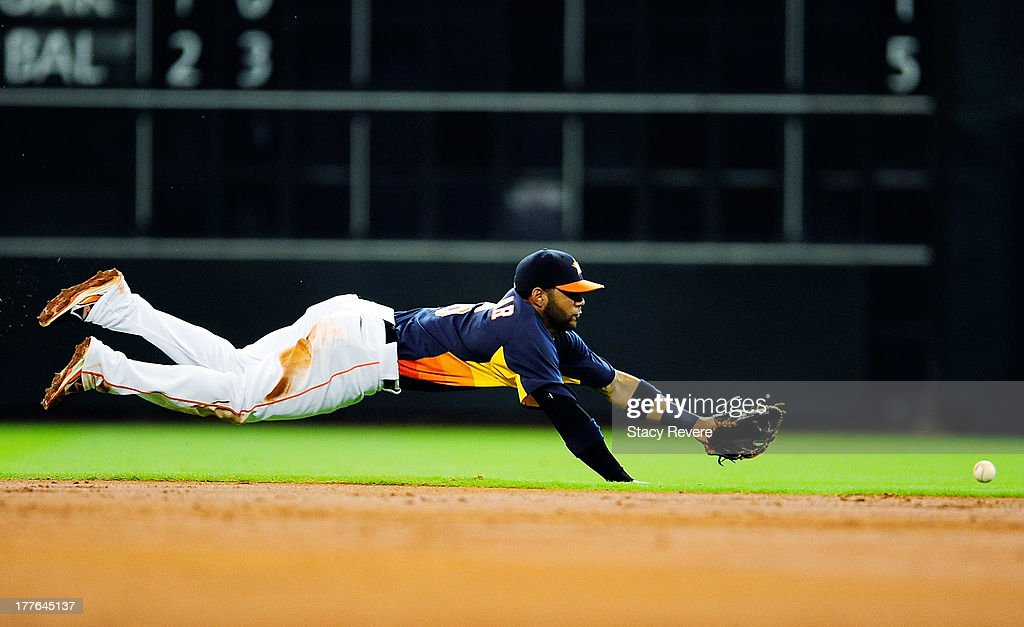 Jonathan Villar #6 of the Houston Astros dives for a ball in the third inning during a game against the Toronto Blue Jays at Minute Maid Park on August 25, 2013 in Houston, Texas.
