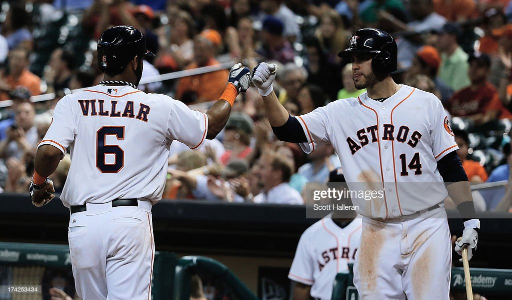 Jonathan Villar of the Houston Astros is greeted by JD Martinez after Villaar scored a run in the third inning against the Oakland Athletics at...